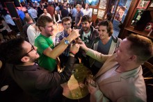 A group of young entrepreneurs working in startup companies gather at the 'Final Final' bar in the Marina area in San Francisco to watch game 7 of the NBA 2013 finals.