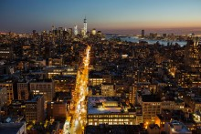 A view of Downtown Manhattan and 6th Avenue after sunset.