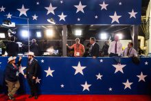 Attendees cheer as Donald Trump makes his entrance to the main stage before presenting his wife on the first day of the Republican National Convention